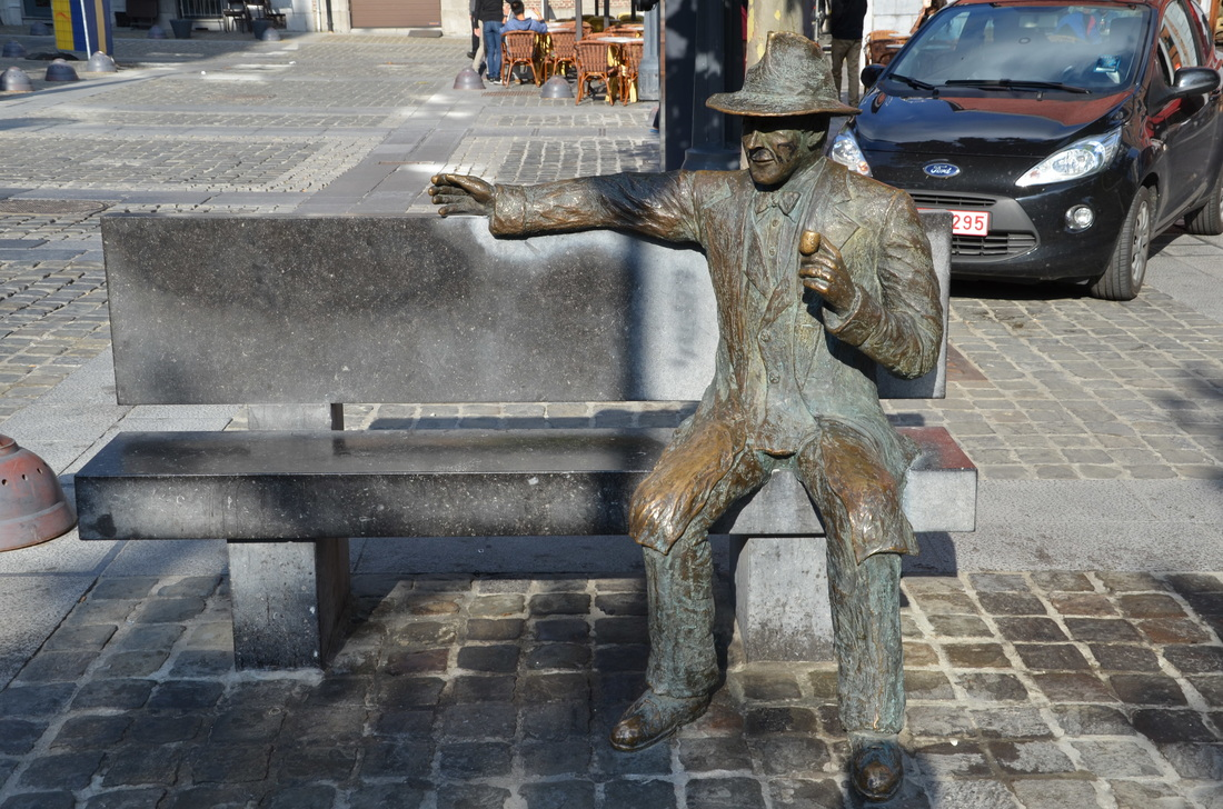 A monument in the form of a bench, on which sits the famous crime writer Georges Simenon. Liege, Belgium.